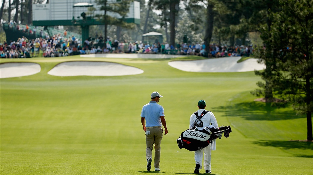 アダム・スコット and his caddie walking the fairways of Augusta National Glf Club during action at The Masters